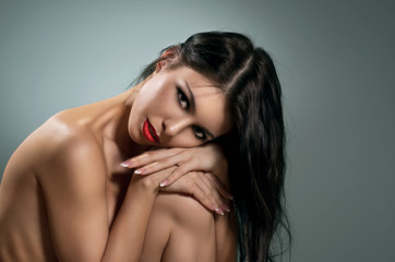 Beautiful naked brunette. Portrait.