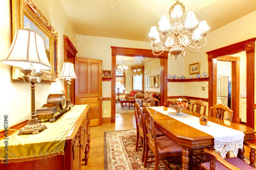 Historical American old house dining room with lots of wood.