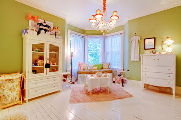 Charming antique baby room with green and white.