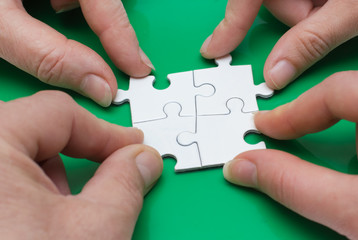 Four people with puzzle