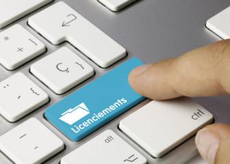 Licenciements clavier doigt