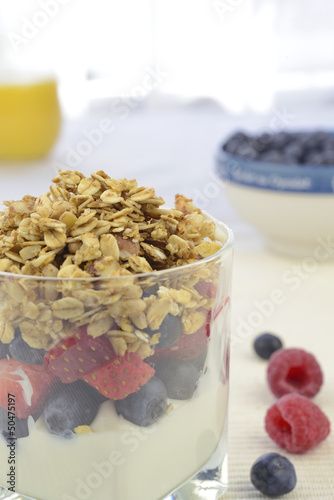 Yogurt with fresh berries and muesli (Vertical)