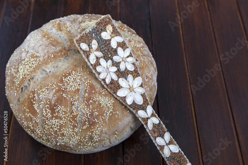 Freshly baked organic bread and with various seeds strewn
