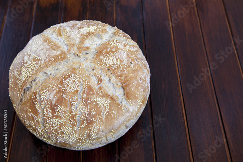 Freshly baked organic bread with various seeds - Close up