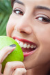 Closeup of woman eating an apple