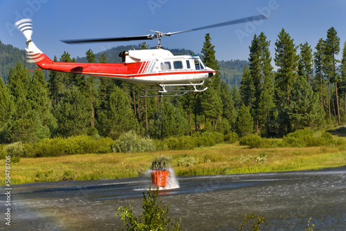Helicopter bucket is full of water ready to fight a fire