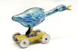 old tin toy blue duck with wheels and swivel neck