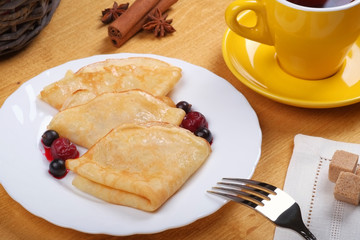 Fried pancakes with fruit
