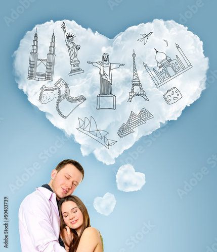 Young beautiful couple dreaming about their vacation. Famous tou