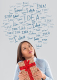Gift Idea concept. Young business woman with gift and  idea sign