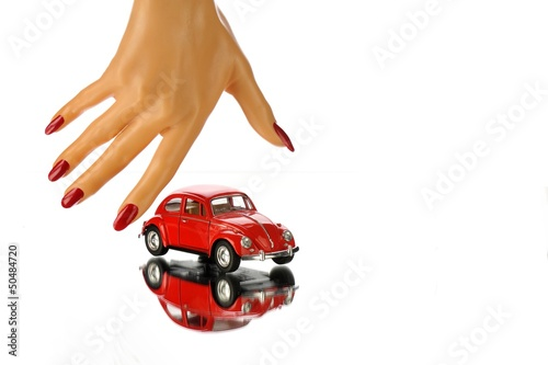 woman hands holding red car isolated on white background