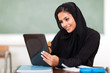 Arabian teen girl using tablet computer