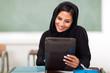 beautiful Arabian teenage girl using tablet computer