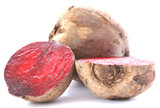 Two whole beetroots on white background one cut in half