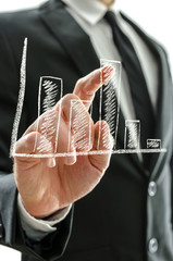 Businessman's hand pointing at graph