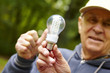 Senior man showing eco diode bulb