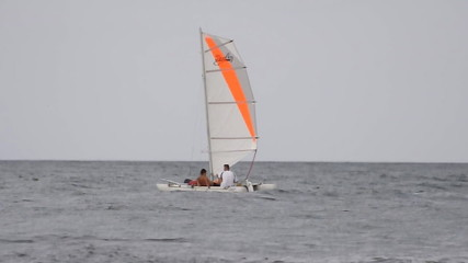 Sailing boat and motor boat on the sea surface