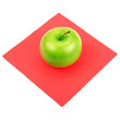Green apple on red napkin isolated on white background