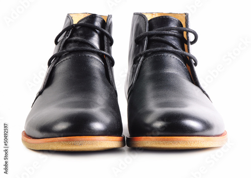 Pair of modern black leather shoes with laces isolated