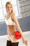 Happy gymnast with ball