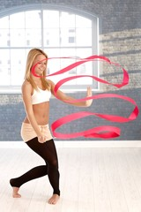 Rhytmic gymnast exercising with ribbon