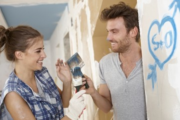 Loving couple having fun at renovation