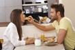 Loving couple having breakfast together
