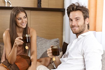 Attractive couple having tea at home