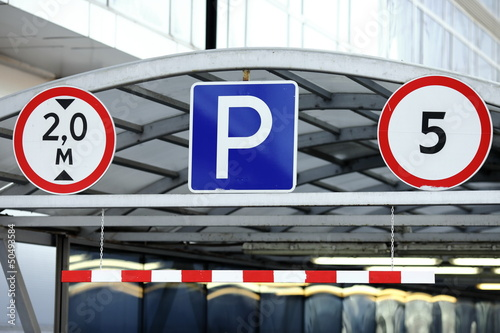Parking signs at the entrance of underground garage