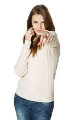 Expressive female with cell phone pointing at you