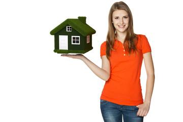 Happy female holding green eco house