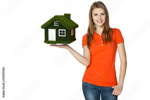 Happy female holding green eco house