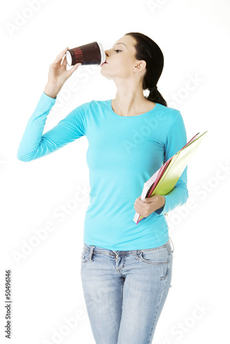 Young student or businesswoman drinking coffee or tea