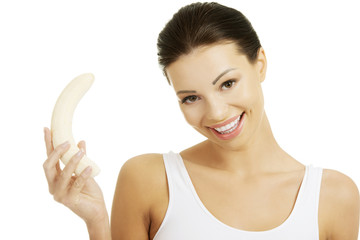 Attractive fit woman eating banana