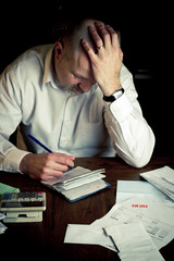 Man struggling with household finances