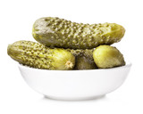 Pickles (gherkins) in small bowl isolated on white background