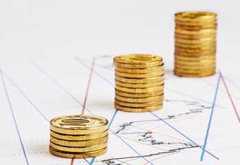 Rising stacks of coins on financial chart