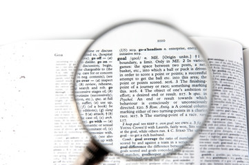 A magnifying glass on the word goal