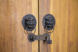 Lion head door knocker on the wood door