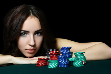The beautiful woman with casino chips