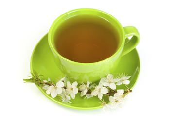 Cherry green tea in a mug