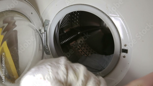 Throwing clothes to washing machine