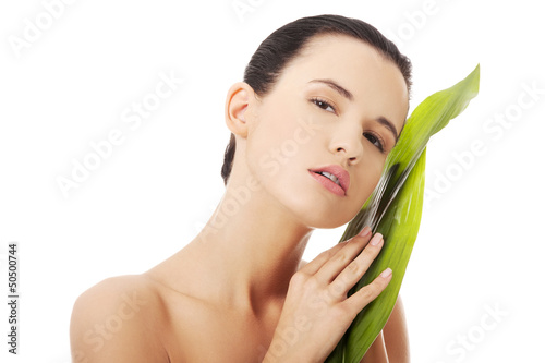 Beautiful woman with green exotic leaf