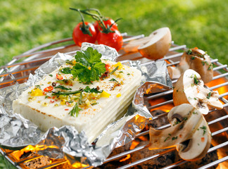 Halloumi or feta cheese on a barbecue