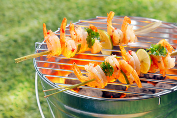 Seafood kebabs roasting on a barbecue