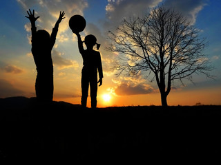 children playing in nature - sunset time