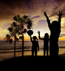 children playing on beach - sunset time