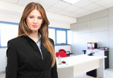 Young businesswoman in her office