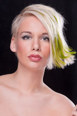 Portrait of alternative blond model with green highlights