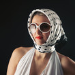 Retro woman with sunglasses fashion portrait against black